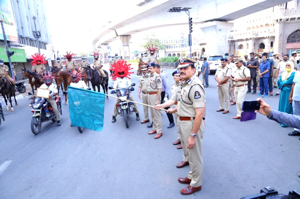 Hyderabad Police Commissioner Anjani Kumar flags off a special police team wearing 'Corona Helmets' launched to dissuade people from flouting curfew to stay safe from COVID-19 on Day 7 of ...