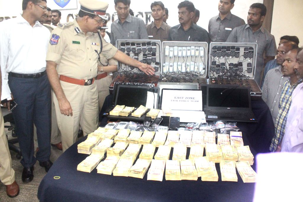 Hyderabad Police Commissioner M. Mahender Reddy presents before press cash and other things recovered after busting a cricket betting racket spread across four states in Hyderabad, on July ...
