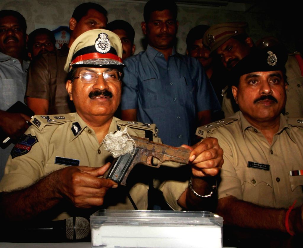 Hyderabad Police Commissioner Mahender Reddy presents gun recovered by the police used in the Vikram Goud firing case in Hyderabad on Aug 2, 2017. The police  arrested five accused in the ...