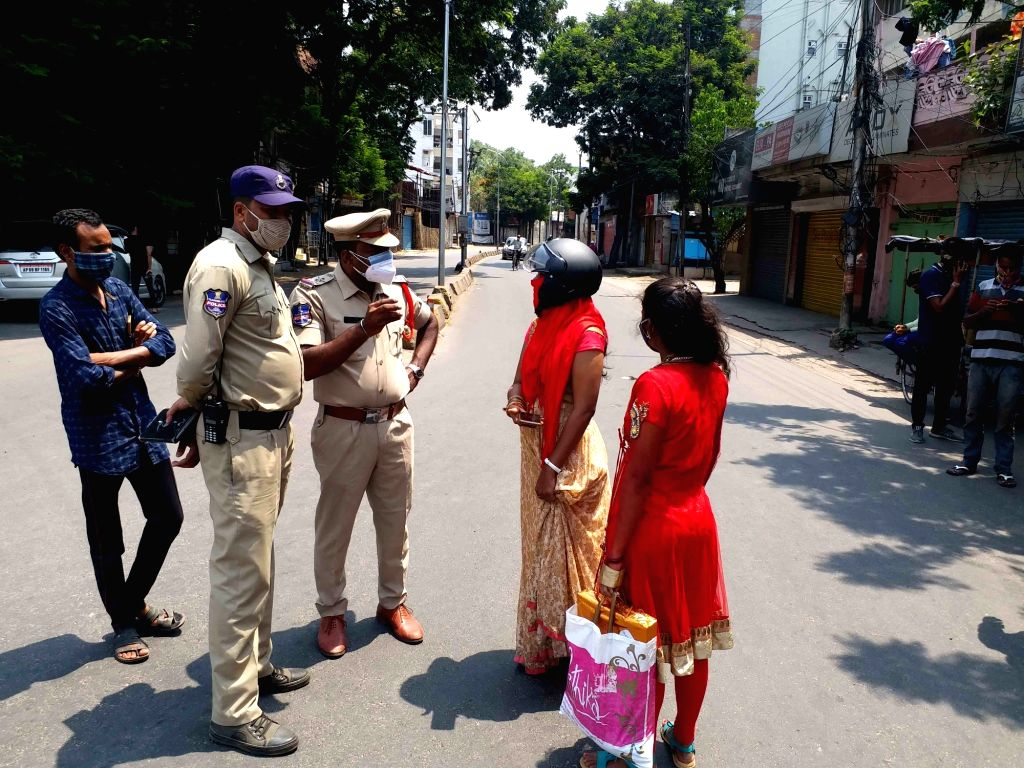 Hyderabad :  Police personnel checking and seized vehicle of  Girls and women???s going to marriage party during the lockdown imposed to curb at Gousha mahal Circle  on Sunday  in Hyderabad 23 May ...