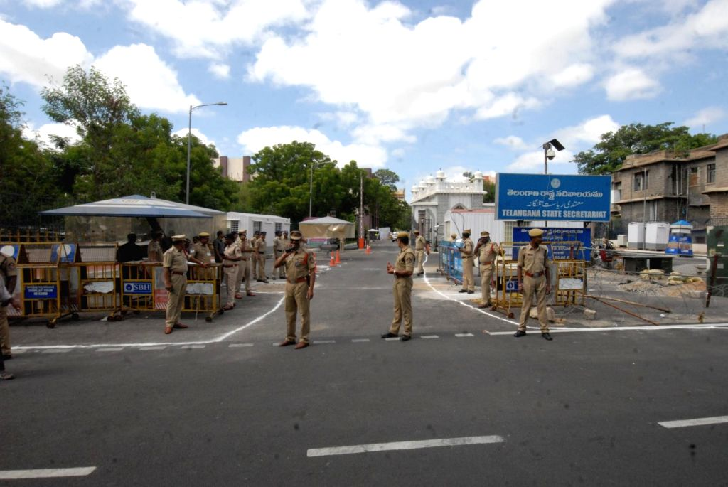 Hyderabad: Police personnel deployed outside the Telangana State Secretariat where Congress workers staged a demonstration against the TRS government's move to construct a new Secretariat by demolishing the existing buildings, in Hyderabad on June 27