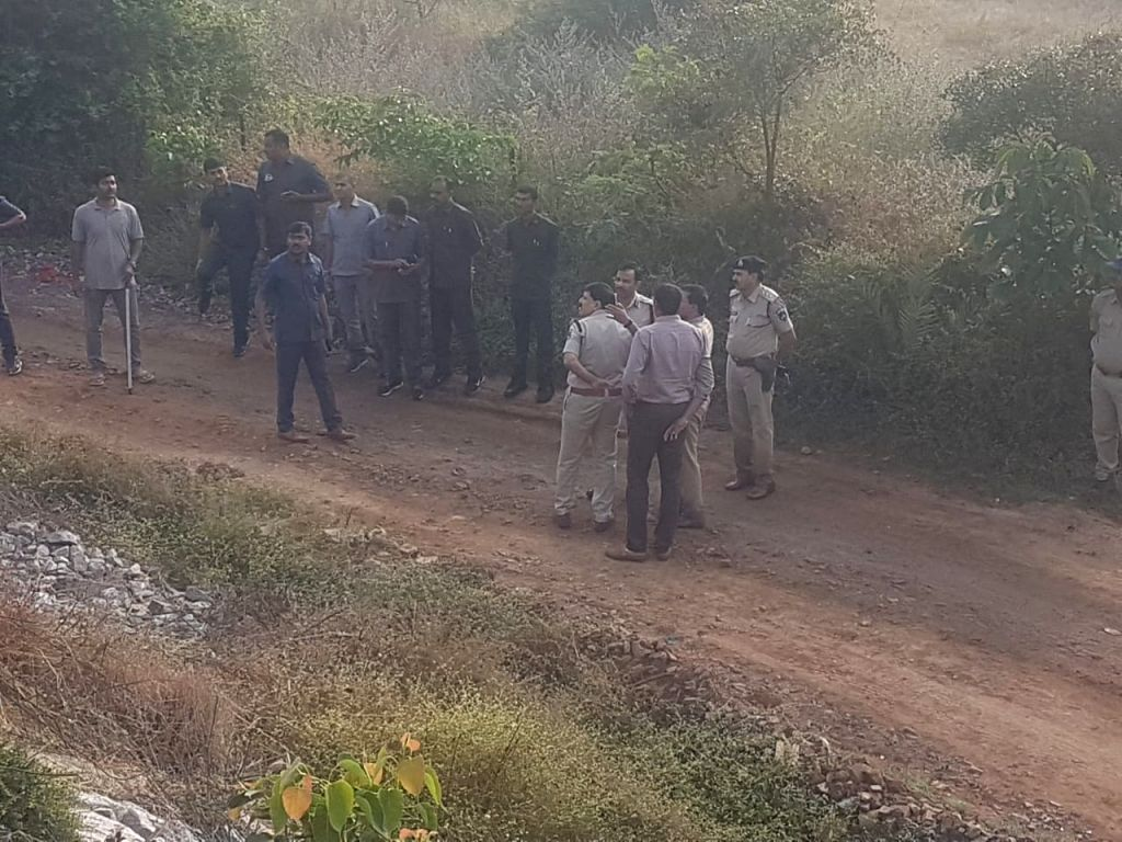 Hyderabad: Police personnel present at the site where they shot dead all the four accused in gang rape and murder of a young veterinarian in Hyderabad, in an alleged 'encounter' near Shadnagar town of Telangana's Ranga Reddy district on Dec 6, 2019.  - Ranga Reddy