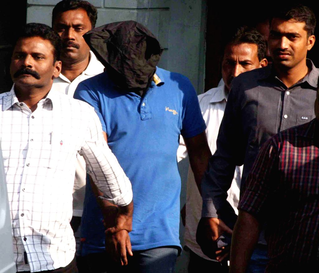 Police produce AR constable Obulesh, plotter behind kidnap attempt on Arabindo Pharma`s vice chairman Nityananda Reddy before the Nampally court in Hyderabad on Nov. 22, 2014. - Nityananda Reddy