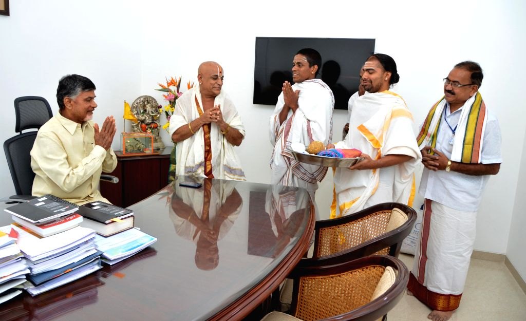 Priests bless Andhra Chief Minister N. Chandrababu Naidu on his birthday in Hyderabad, on April 20, 2015.