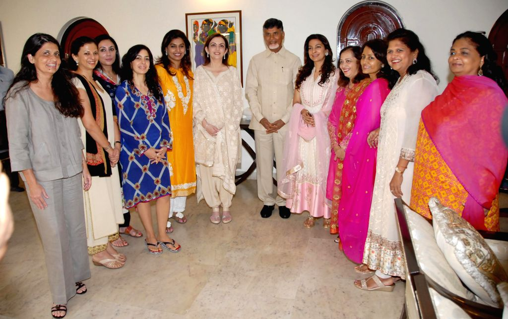 Reliance Foundation Chairman Nita Ambani and others meeting Andhra Pradesh Chief Minister N Chandra Babu Naidu to donate for CM Relief Fund in Hyderabad on Nov. 15, 2014.