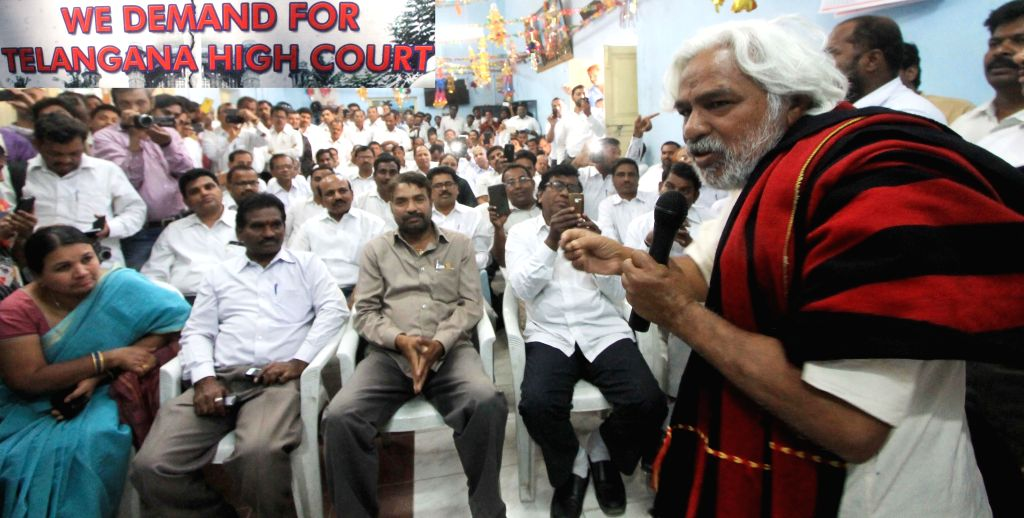 Revolutionary writer Nikhileshwar (popularly known as Gaddar) addresses during a rally organised by Telanagana lawyers to press for their demand of separate Telangana High Court at ...
