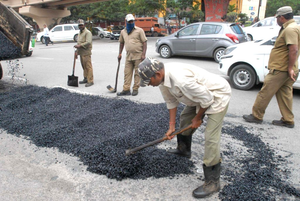 Hyderabad: Road repair work underway after the city's roads developed several potholes during the ongoing monsoon season, in Hyderabad on July 18, 2018. (Photo: IANS)