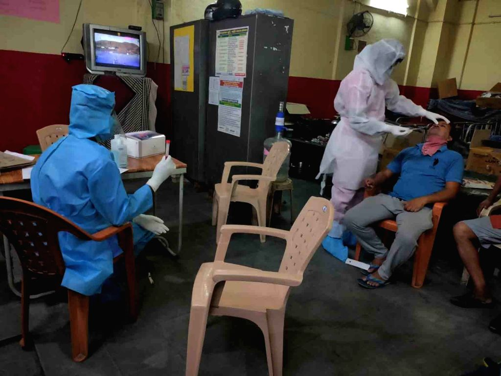 Hyderabad: Samples of people from Containment zones identified in Hyderabad being collected for COVID-19 testing during the extended nationwide lockdown imposed to mitigate the spread of coronavirus; on Apr 18, 2020. (Photo: IANS)