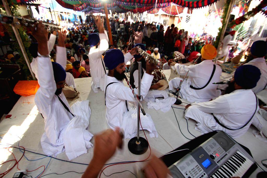 Sikhs participate in 350th birth anniversary celebrations of Guru Gobind Singh at the Central Gurudwara Gowliguda in Hyderabad, on Dec 28, 2014.