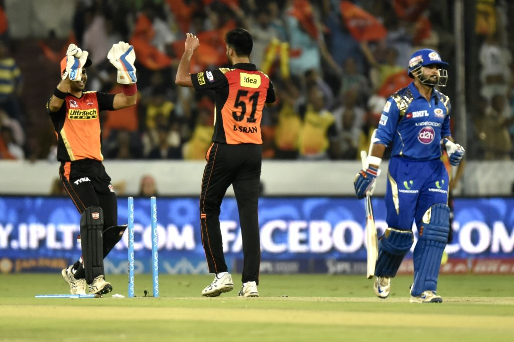 Hyderabad: Sunrisers Hyderabad players celebrate fall of a wicket during an IPL match between Sunrisers Hyderabad and Mumbai Indians at Rajiv Gandhi International Stadium in Hyderabad, on ...