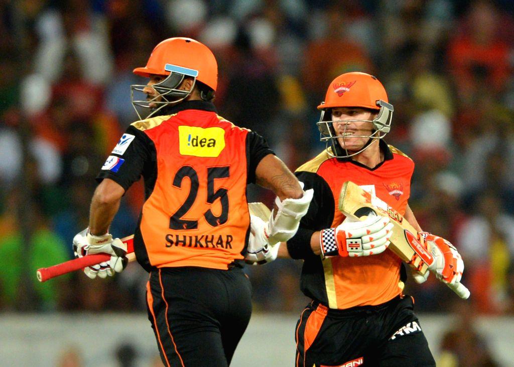 Sunrisers Hyderabad players David Warner and Shikhar Dhawan in action during an IPL-2015 match between Chennai Super Kings and Sunrisers Hyderabad at Rajiv Gandhi International Stadium, ... - Shikhar Dhawan