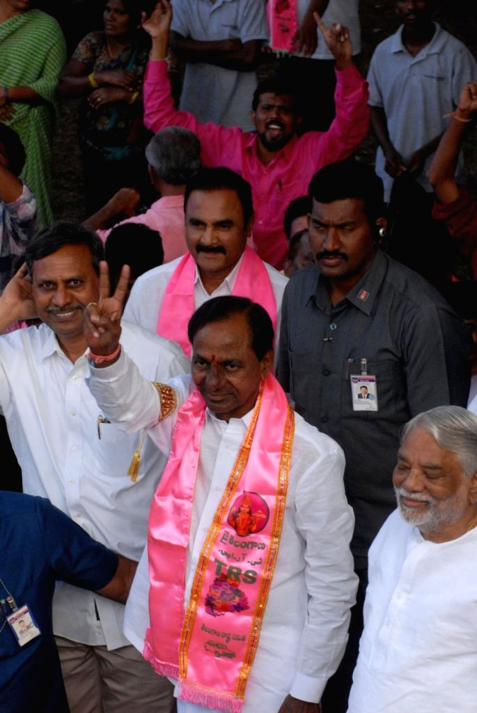 : Hyderabad: Telangana caretaker Chief Minister and Telangana Rashtra Samithi president (TRS) K. Chandrashekar Rao shows victory sign after the party swept Telangana Assembly elections, in Hyderabad ...