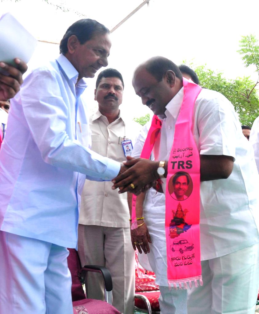 Telangana Chief Minister K Chandrasekhar Rao welcomes newly joined party members during a programme in Hyderabad, on Nov 9, 2014. - K Chandrasekhar Rao