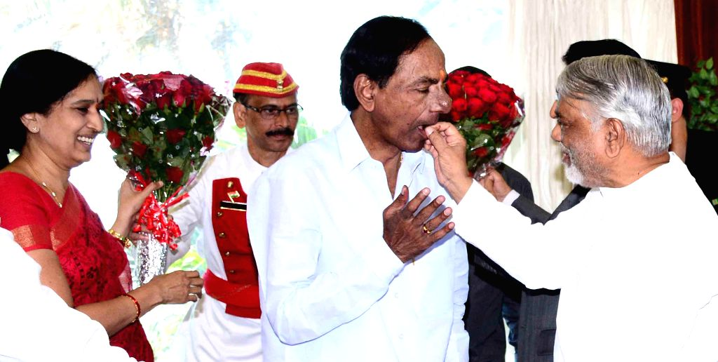 Telangana Chief Minister K Chandrasekhar Rao with TRS general secretary K. Keshava Rao and others during his birthday celebrations in Hyderabad, on Feb 17, 2015. - K Chandrasekhar Rao and K. Keshava Rao