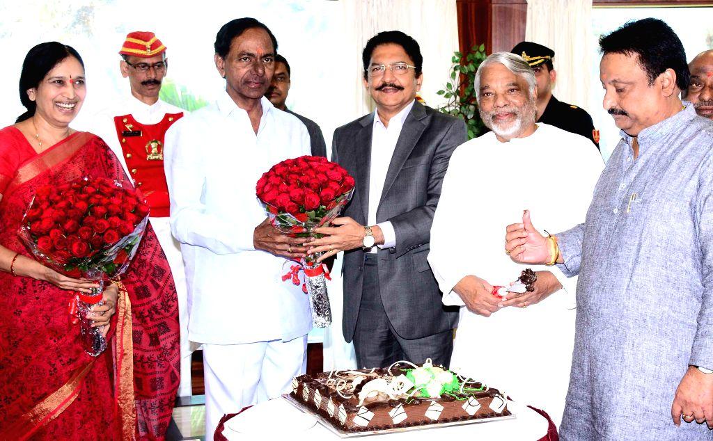 Telangana Chief Minister K Chandrasekhar Rao with Maharashtra Governor Chennamaneni Vidyasagar Rao, TRS general secretary K. Keshava Rao and others during his birthday celebrations in ... - K Chandrasekhar Rao, Chennamaneni Vidyasagar Rao and K. Keshava Rao