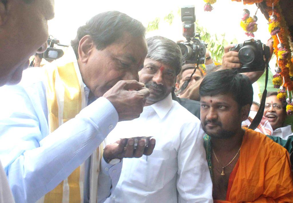 Telangana Chief Minister K Chandrasekhar Rao tastes Pachadi during a programme organised to celebrate Ugadi in Hyderabad on March 21, 2015. - K Chandrasekhar Rao