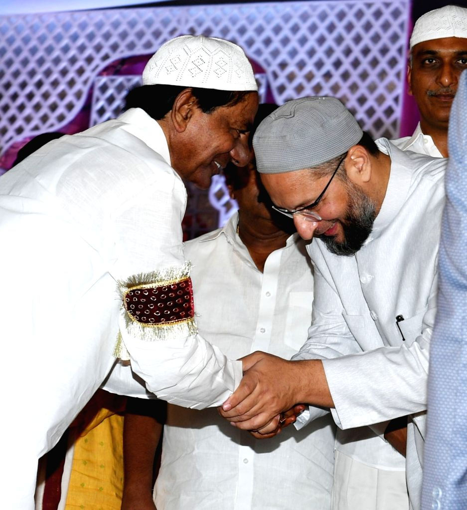 : Hyderabad: Telangana Chief Minister K Chandrasekhar Rao with AIMIM President Asaduddin Owaisi during an iftaar party hosted by him in Hyderabad on June 8, 2018. (Photo: IANS).