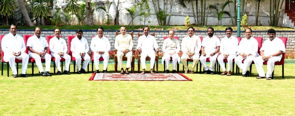 Hyderabad: Telangana Chief Minister K. Chandrashekhar Rao and Governor E.S.L. Narasimhan with the newly inducted ministers in Hyderabad, on Feb 19, 2019. The ministers who took oath are A. Indrakaran Reddy, Eatala Rajender, Koppula Eshwar, T. Sriniva - K. Chandrashekha, A. Indrakaran Reddy, T. Srinivas Yadav, V. Prashanth Reddy, S. Niranjan Reddy, E. Dayakar Rao, Malla Reddy and G. Jagadishwar Reddy