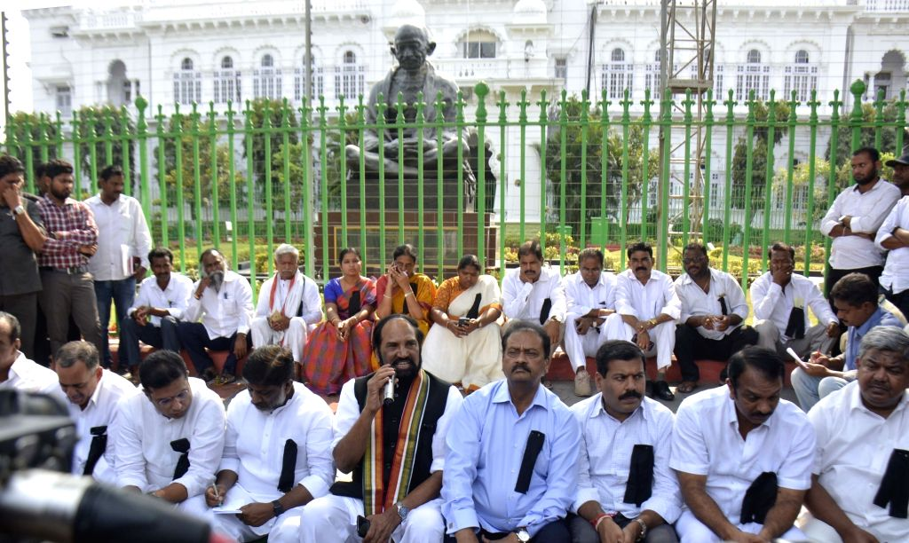 Hyderabad: Telangana Congress chief N. Uttam Kumar Reddy along with Congress Legislature Party (CLP) leader Mallu Bhatti Vikramarka and other MLAs and MLCs wearing black badges stage a sit-in at the Assembly premises protesting against the ruling Tel
