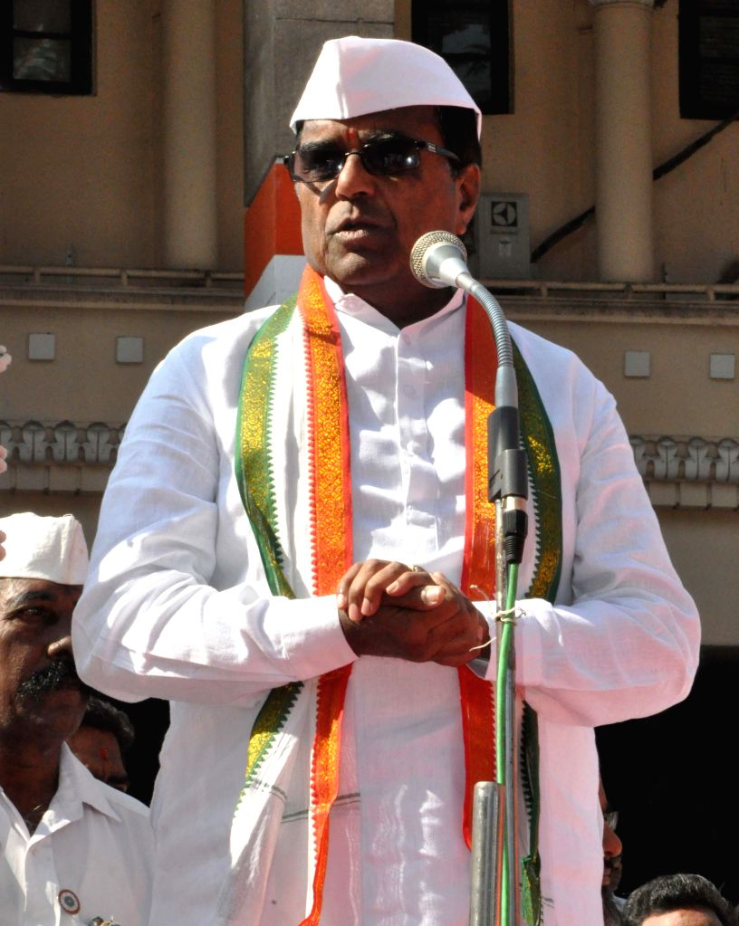 Telangana Congress chief Ponnala Lakshmaiah addresses during a programme organised on the foundation day of the party in Hyderabad, on Dec 28, 2014.
