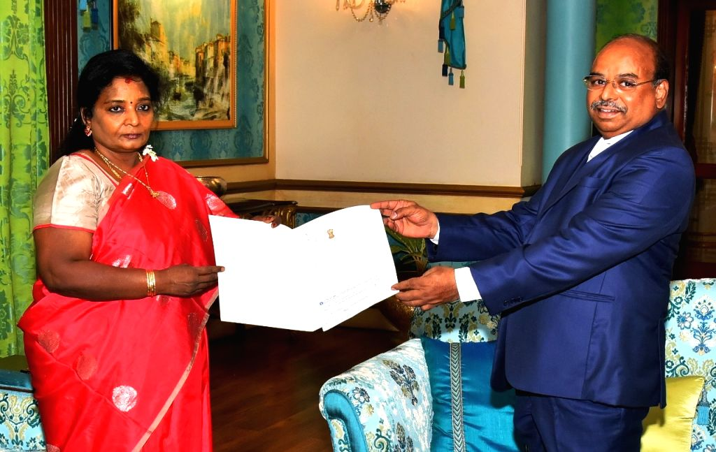 Hyderabad: Telangana Governor Tamilisai Soundararajan donates her one month's salary to the Chief Minister's Relief Fund as she hands over a chequeue of Rs 3.5 lakh to Principal Secretary, Disaster Management M. Jagadeeshwar amid COVID-19 pandemic, a