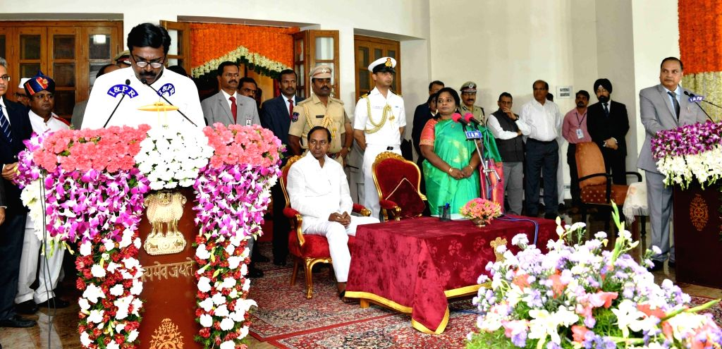 Hyderabad: Telangana Governor Tamilisai Soundararajan in the presence Chief Minister K Chandrashekar Rao, administers the oath of office to TRS MLA Puvvada Ajay Kumar as a Cabinet Minister during a swearing-in ceremony, in Hyderabad on Sep 8, 2019. ( - K Chandrashekar Rao and Puvvada Ajay Kumar