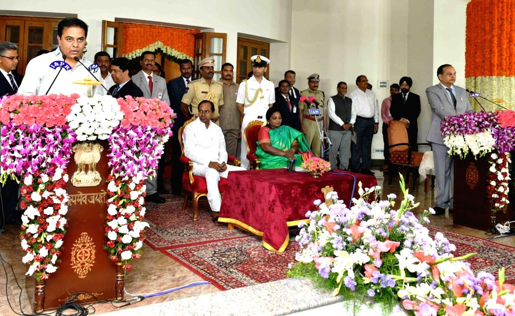 Hyderabad: Telangana Governor Tamilisai Soundararajan in the presence Chief Minister K Chandrashekar Rao, administers the oath of office to TRS MLA K. T. Rama Rao as a Cabinet Minister during a swearing-in ceremony, in Hyderabad on Sep 8, 2019. (Phot - K Chandrashekar Rao