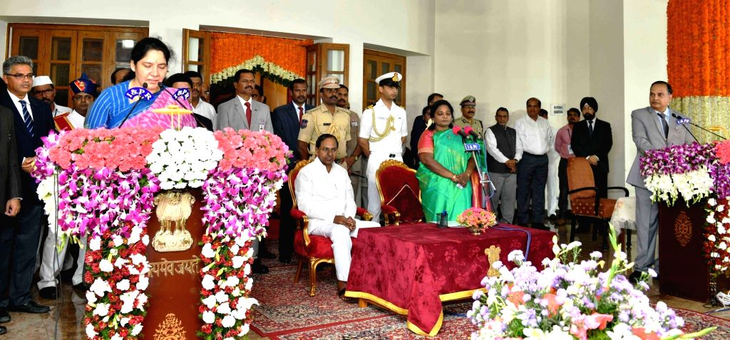 Hyderabad: Telangana Governor Tamilisai Soundararajan in the presence Chief Minister K Chandrashekar Rao, administers the oath of office to TRS MLA Satyavathi Rathod as a Cabinet Minister during a swearing-in ceremony, in Hyderabad on Sep 8, 2019. (P - K Chandrashekar Rao