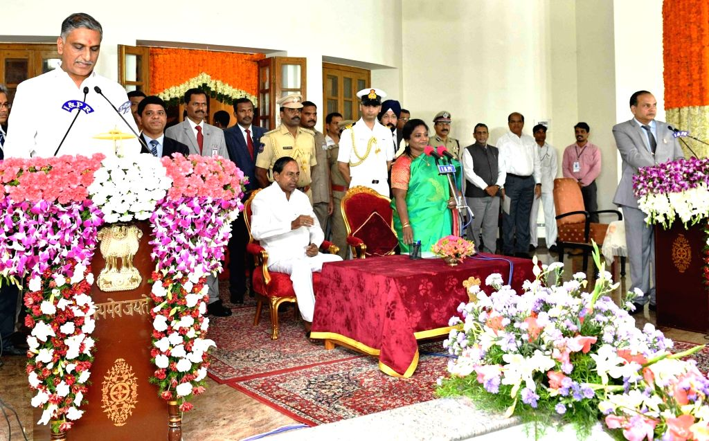 Hyderabad: Telangana Governor Tamilisai Soundararajan in the presence Chief Minister K Chandrashekar Rao, administers the oath of office to TRS MLA T. Harish Rao as a Cabinet Minister during a swearing-in ceremony, in Hyderabad on Sep 8, 2019. (Photo - K Chandrashekar Rao and T. Harish Rao