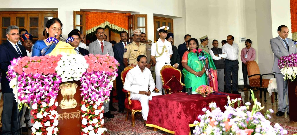 Hyderabad: Telangana Governor Tamilisai Soundararajan in the presence Chief Minister K Chandrashekar Rao, administers the oath of office to TRS MLA Sabitha Indra Reddy as a Cabinet Minister during a swearing-in ceremony, in Hyderabad on Sep 8, 2019.  - K Chandrashekar Rao and Sabitha Indra Reddy