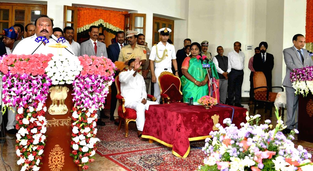 Hyderabad: Telangana Governor Tamilisai Soundararajan in the presence Chief Minister K Chandrashekar Rao, administers the oath of office to TRS MLA Gangula Kamalakar as a Cabinet Minister during a swearing-in ceremony, in Hyderabad on Sep 8, 2019. (P - K Chandrashekar Rao