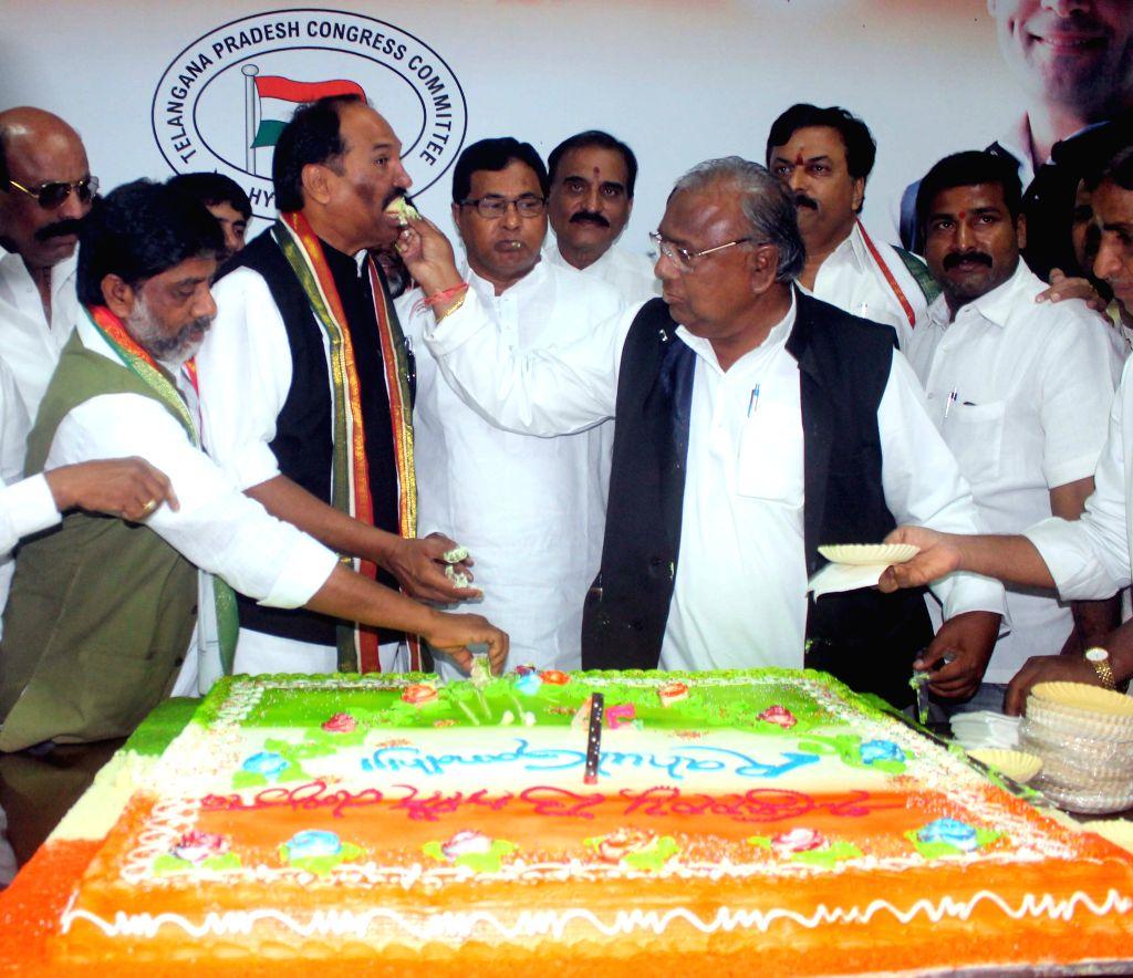 Telangana Pradesh Congress Committee (TPCC) chief N. Uttam Kumar Reddy, Leaders of Opposition in the Assembly and Council K Jana Reddy and Telangana Congress MP V Hanumantha Rao celebrates ... - K Jana Reddy, V Hanumantha Rao and Rahul Gandhi