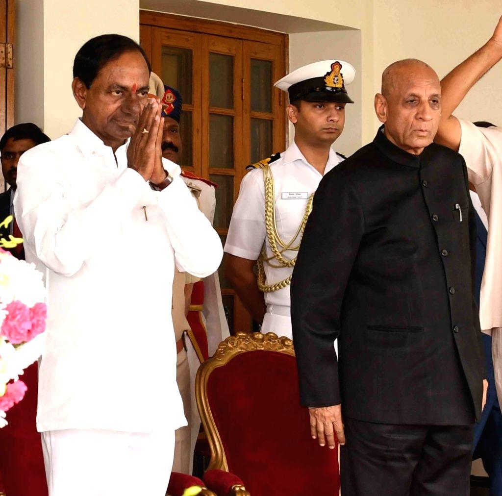 :Hyderabad: Telangana Rashtra Samithi (TRS) leader K. Chandrashekhar Rao takes oath as the Chief Minister of Telangana at Raj Bhawan in Hyderabad on Dec 13, 2018. Governor E.S.L. Narasimhan ...