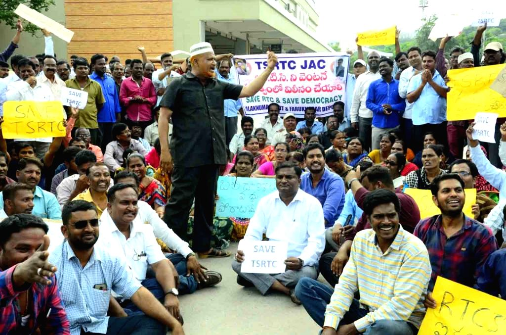 Hyderabad: Telangana State Road Transport Corporation (TSRTC) employees stage a demonstration in Hyderabad on Oct 15, 2019. (Photo: IANS)