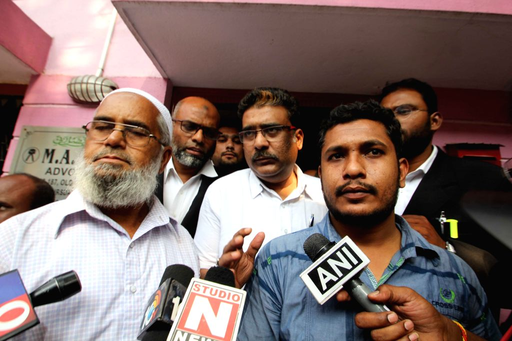 The father and the brother of  Viqaruddin, who along with four associates was gunned down by police while trying to escape in Telangana's Warangal district, talk to press at Malakpet in ...