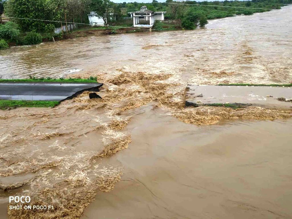 Hyderabad: The temporary bridge between Kodangal and Tandur which was laid for the movement of light motor vehicles was damaged due to heavy rainfall leading to a transportation blockade between the two areas, on July 3, 2020. (Photo: IANS)