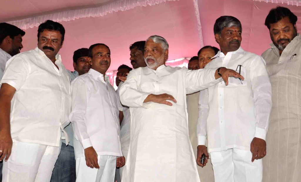 TRS general secretary K. Keshava Rao with party leaders, T Padma Rao Goud and T Srinivas Yadav inspect the preparations for TRS upcoming rally in Hyderabad, on April 23, 2015. - K. Keshava Rao and T Srinivas Yadav