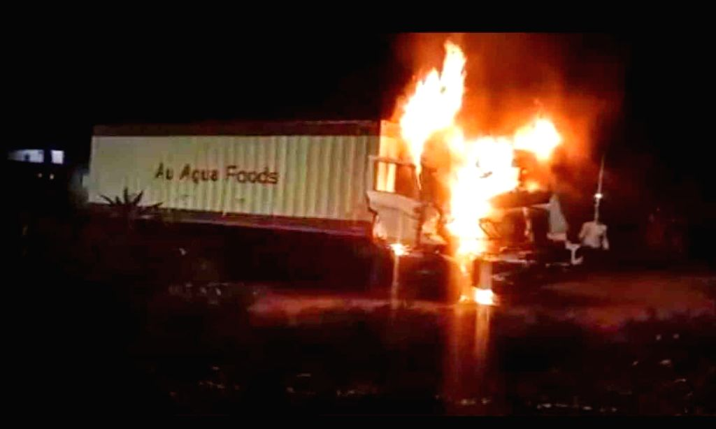 Hyderabad : Two persons were charred to death after a moving container lorry went up in flames on the Outer Ring Road near Himayat Sagar.  The lorry carrying a load of fisheries products from ...