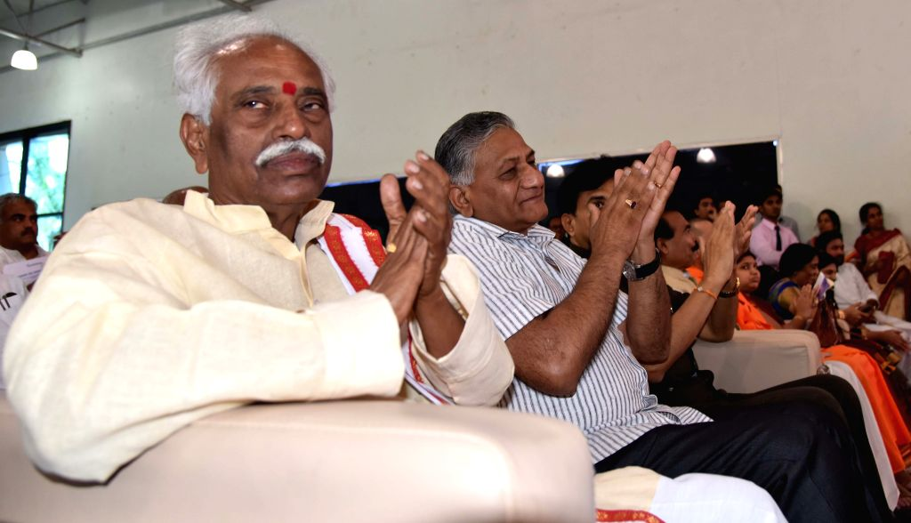 Union labour minister Bandaru Dattatreya and Union Minister of State for External Affairs V K Singh during a yoga session in Hyderabad on June 18, 2015. - Bandaru Dattatreya