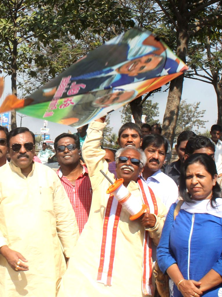 Union Minister of State for Labour and Employment (Independent Charge), Bandaru Dattatreya flies a kite depicting pictures of  Prime Minister Narendra Modi and US President Barack - Narendra Modi