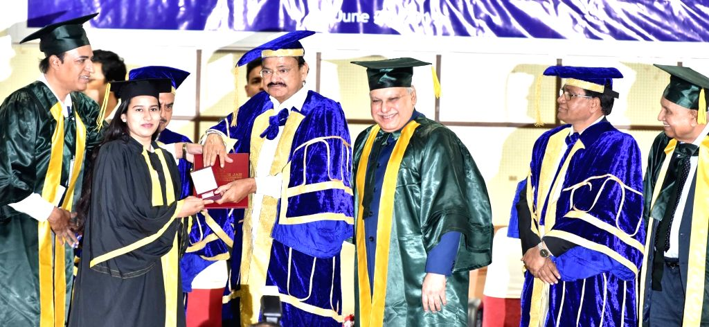 Hyderabad: Vice President M. Venkaiah Naidu presents Gold Medal to a student at the Graduation Day Ceremony of the Muffakham Jah College of Engineering and Technology, in Hyderabad on June 29, 2019. Speaking at the ceremony, Vice President M. Venkaia - M. Venkaiah Naidu