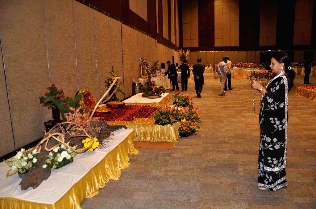 Visitors looking at the displayed roses at the 35th Annual Rose Show organised by Hyderabad Rose Society at Jubilee Hall in Hyderabad on Nov. 29, 2014.