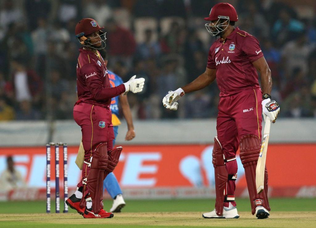 Hyderabad: West Indies' Kieron Pollard and Shimron Hetmyer during the first T20I match between India and West Indies at the Rajiv Gandhi International Stadium in Hyderabad on Dec 6, 2019. (Photo: Surjeet Yadav/IANS) - Surjeet Yadav