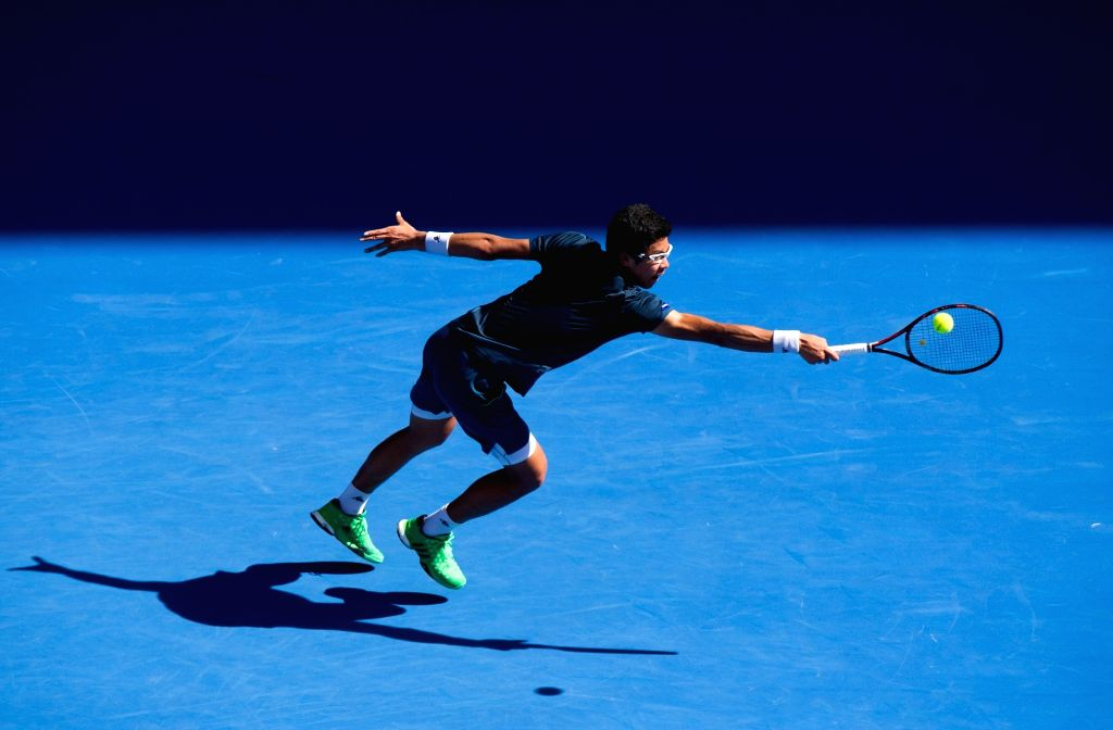 Hyeon Chung of South Korea returns the ball during the first-round match of men's singles of Australian Open Tennis Championships against Novak Djokovic of Serbia ...
