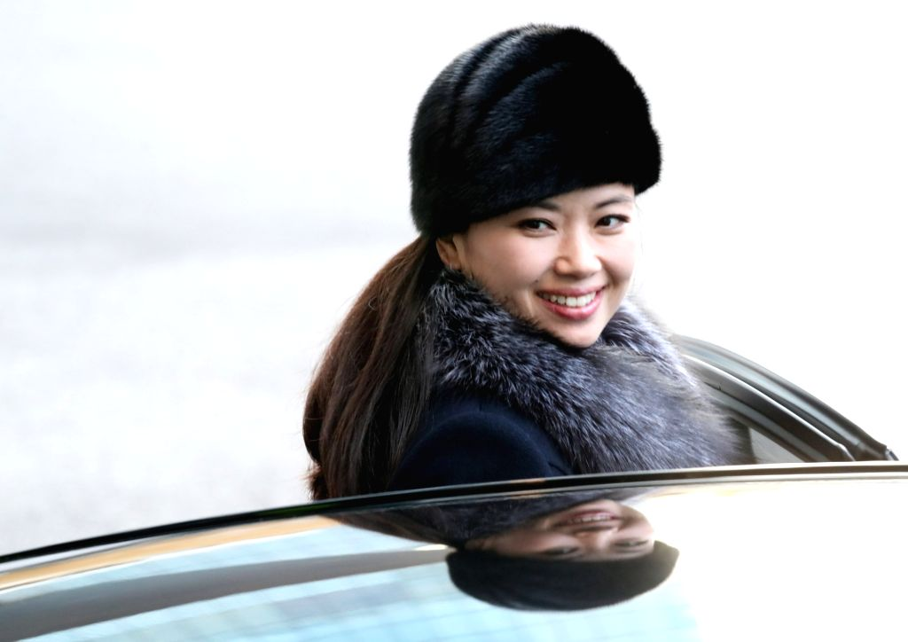 Hyon Song-wol, leader of the North Korean art troupe, gets into a car at Grand Walkerhill hotel in eastern Seoul on Feb. 12, 2018, to return to Pyongyang by land after two performances in ...