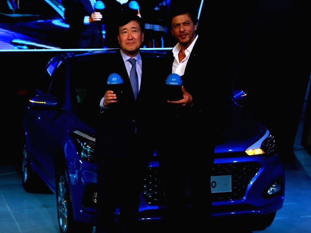 Hyundai Corporate Brand Ambassador Shah Rukh Khan and Hyundai Motor India Ltd MD and CEO Y K Koo unveil 'Swachh Can', a portable bin for all Hyundai Cars at the Auto Expo 2018 in New ... - Rukh Khan