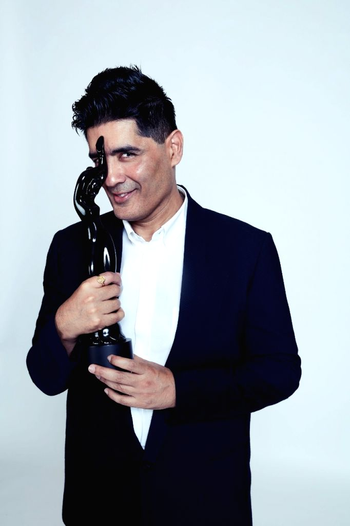 """""""I sometimes fail to understand that why there's a subtle disdain between cinema and fashion. I feel both are creative mediums and the merging of two makes it a brilliant case,"""" says designer Manish Malhotra who received the Filmfare Award of Honour  - Manish Malhotra"""
