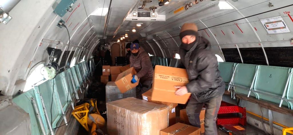 IAF aircraft being loaded with essential medical supplies which include Personal Protective Equipment, Hand sanitizers, surgical gloves, thermal scanners etc to be airlifted to various ...