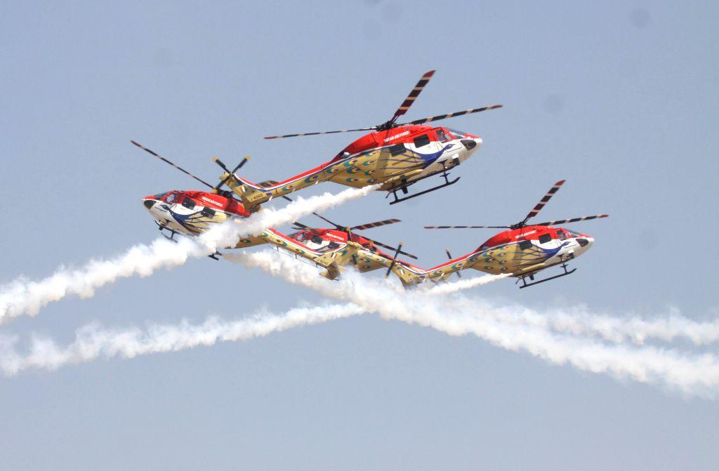 IAF aircrafts perform aerobatics during the Aero India-2015 Air Show, at Yelahanka Air-force Station, in Bengaluru on Feb 18, 2015.