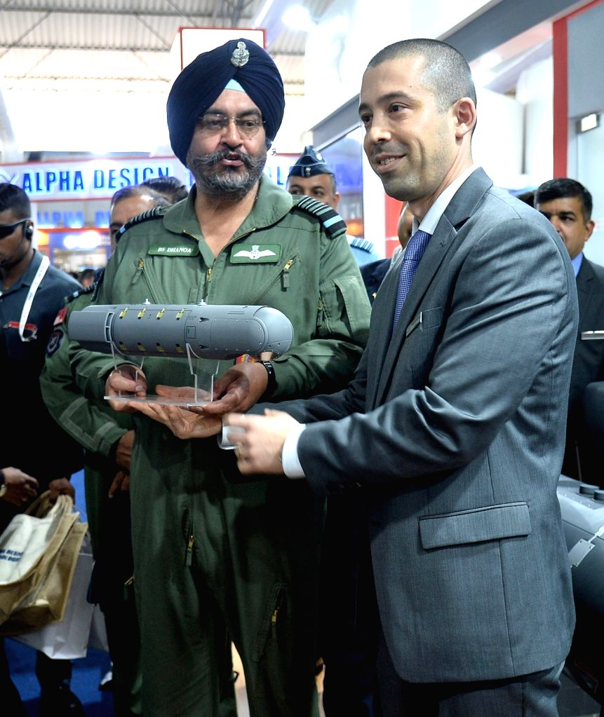 "IAF chief Air Chief Marshal BS Dhanoa at a ""Aero India 2019"" stall at Yelahanka Air Force Station in Bengaluru on Feb 22, 2019."
